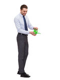Handsome buisnessman with green watering can Royalty Free Stock Image