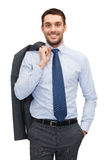 Handsome buisnessman with jacket over shoulder Royalty Free Stock Photo