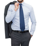 Handsome buisnessman with jacket over shoulder Stock Image