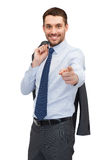 Handsome buisnessman with jacket over shoulder Royalty Free Stock Images