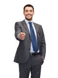 Handsome buisnessman pointing finger at you Royalty Free Stock Photo