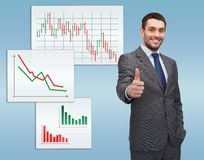 Handsome buisnessman showing thumbs up. Business, gesture and office concept - handsome buisnessman showing thumbs up Royalty Free Stock Photo