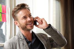 Handsome business casual man talking on phone Stock Images