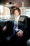 Handsome business corporate inside taxi cab Stock Images