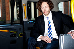 Handsome business corporate inside taxi cab Stock Photos