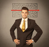 Handsome business guy solving maze Stock Photo