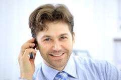 Handsome business guy working on Royalty Free Stock Photos