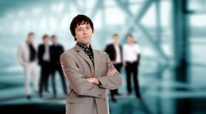 Handsome business man. With colleagues at the back Royalty Free Stock Photography