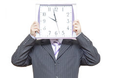 Handsome business man. A man in business suit with clocks instead of head Royalty Free Stock Photography