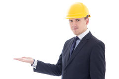 Handsome business man or architect in yellow builder's helmet ho Royalty Free Stock Photo