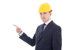 Handsome business man or architect in yellow builder's helmet po Stock Images