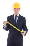 Handsome business man or architect in yellow builder's helmet wi Stock Images