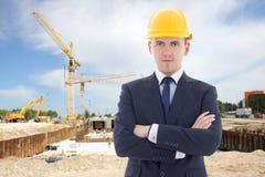 Handsome business man in builder's helmet Stock Photo