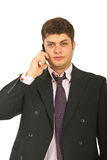 Handsome business man by cellphone Stock Image