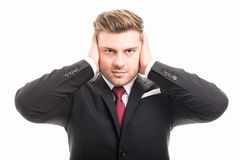 Handsome business man covering ears like deaf gesture Stock Photos