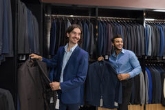 Handsome Business Man Fashion Shop, Customers Choosing Clothes In Retail Store. Handsome Business Man Fashion Shop, Customers Choosing Suit Clothes In Retail Stock Images
