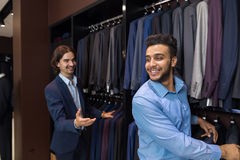 Handsome Business Man Fashion Shop, Customers Choosing Clothes In Retail Store. Handsome Business Man Fashion Shop, Customers Choosing Suit Clothes In Retail Stock Image