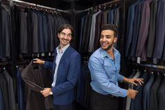 Handsome Business Man Fashion Shop, Customers Choosing Clothes In Retail Store. Handsome Business Man Fashion Shop, Customers Choosing Suit Clothes In Retail Stock Photo