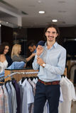 Handsome Business Man Fashion Shop, Customers Choosing Clothes In Retail Store Royalty Free Stock Photography