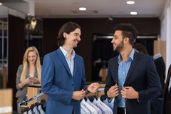 Handsome Business Man Fashion Shop, Customers Choosing Clothes In Retail Store. Young People Shopping Formal Wear Royalty Free Stock Photos