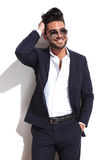 Handsome business man fixing his hair Royalty Free Stock Photo