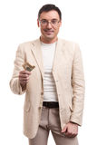 Handsome business man giving money Royalty Free Stock Image
