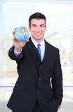 Handsome Business Man with Globe Stock Photo