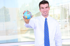 Handsome Business Man with Globe Stock Photography