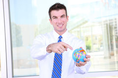 Handsome Business Man with Globe Royalty Free Stock Images