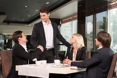 Handsome business man greeting group of people. Royalty Free Stock Images