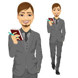 Handsome business man holding notebook Stock Photo