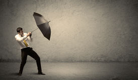 Handsome business man holding umbrella with copy space backgroun Stock Photography
