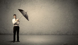 Handsome business man holding umbrella with copy space backgroun Royalty Free Stock Photo