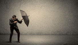 Handsome business man holding umbrella with copy space backgroun Stock Photo