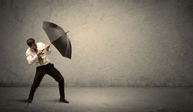 Handsome business man holding umbrella with copy space backgroun Royalty Free Stock Image