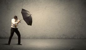 Handsome business man holding umbrella with copy space backgroun Stock Image