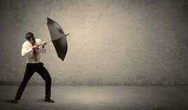 Handsome business man holding umbrella with copy space backgroun Royalty Free Stock Photos