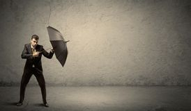 Handsome business man holding umbrella with copy space backgroun Stock Photos