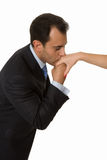 Handsome business man kissing lady s arm royalty free stock images