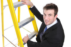 Handsome Business Man on Ladder Stock Photography