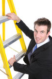 Handsome Business Man on Ladder Royalty Free Stock Photography