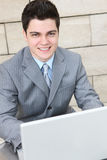 Handsome Business Man with Laptop Royalty Free Stock Photography
