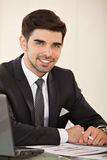 Handsome business man with laptop Stock Images