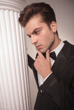 Handsome business man looking down, thinking Stock Images