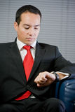 Handsome business man looking at his watch Stock Photography