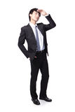 Handsome business man looking to copy space. Successful handsome business man purposefully looking away to empty copy space in full length isolated on white Royalty Free Stock Images
