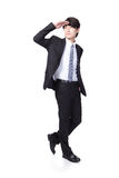 Handsome business man looking to copy space. Successful handsome business man purposefully looking away to empty copy space in full length isolated on white Stock Photography