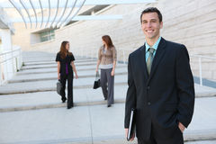 Handsome Business Man at Office. A young handsome business man at office building stock images