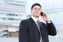 Handsome Business Man at Office on Phone Stock Photography