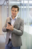 Handsome Business man at the office on phone, sms, e-mail Stock Images